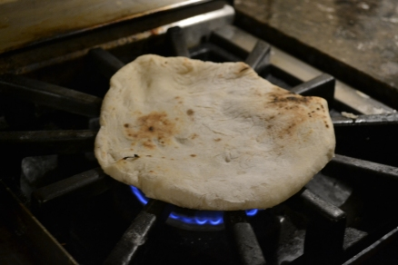 Cooking naan on stove top